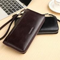 Vì sao nên mua ví cầm tay nam làm từ da bò?